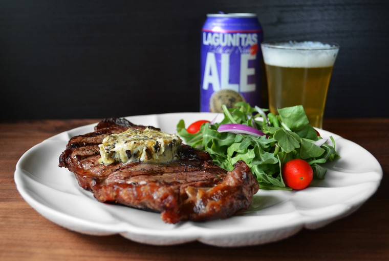 A cook's canvas Grilled Ribeye Steak with Charred Scallion Citrus Compound Butter